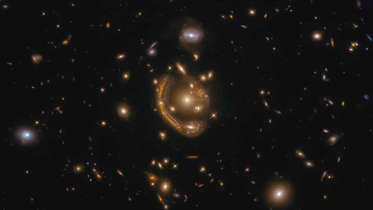 Hubble snapped a photo of a curved galaxy that looks like a molten ring
