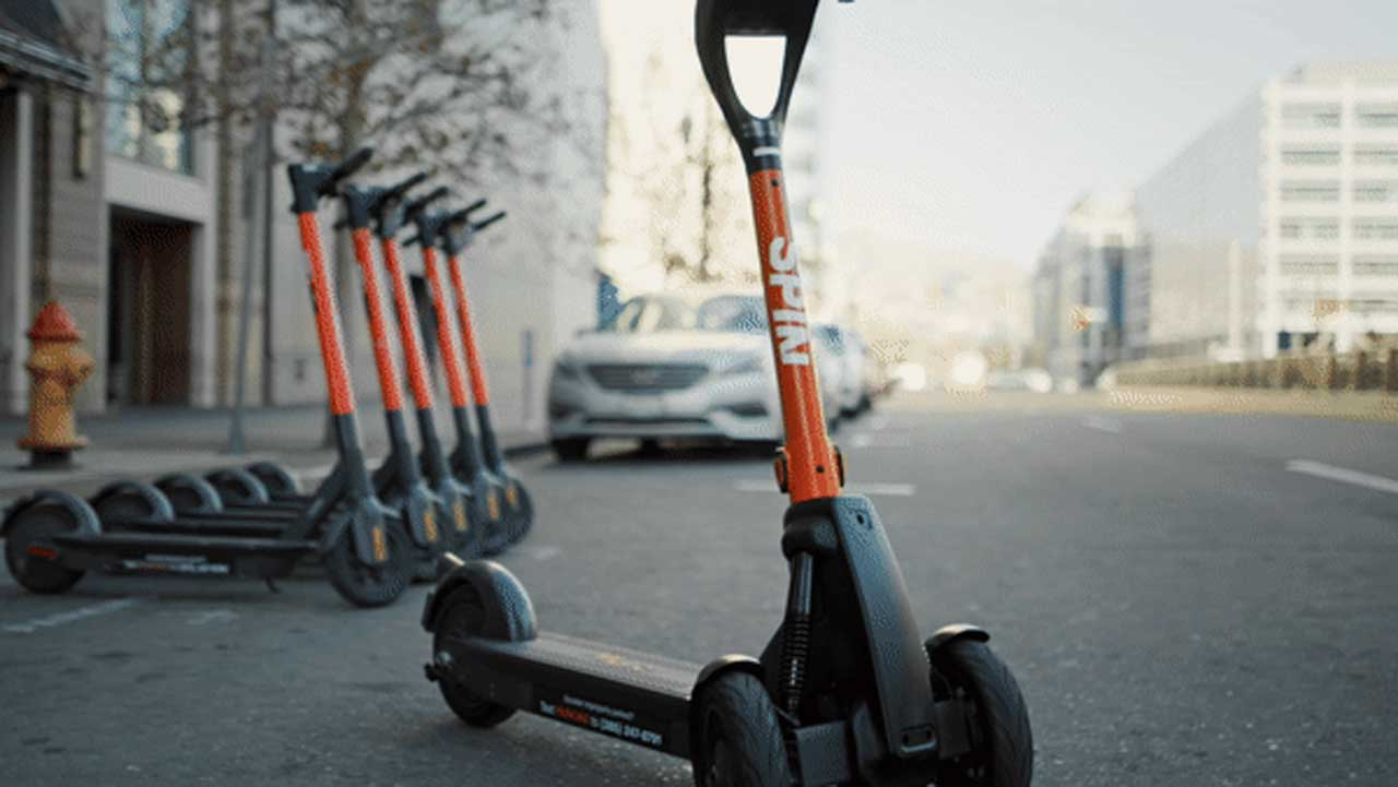 Spin rolling out remote-control e-scooter to park them properly