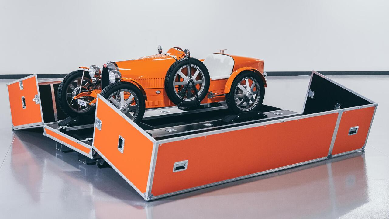 This orange Bugatti Baby II will transfer VIPs to airport terminals in Dubai