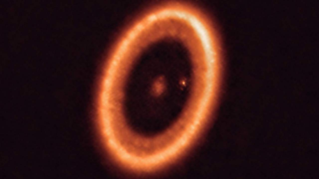 In this glowing exoplanet forge, a moon's birth caught for the first time