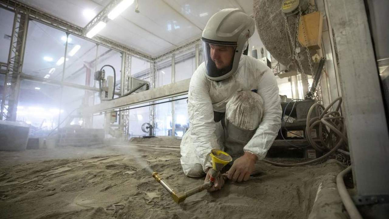 NASA scientists play in 16 tons of simulated lunar regolith
